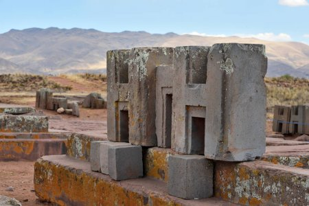 Puma Punku And Tiwanaku Bolivia September 2017 With Engineer Cliff Depositphotos_133235184-stock-photo-ruins-of-pumapunku-or-puma