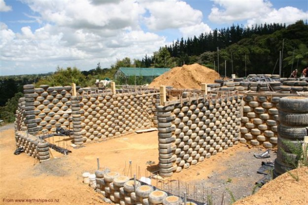 10 Reasons Why EarthShips Are F!#%ing Awesome Earthship-tyre-walls1-625x416