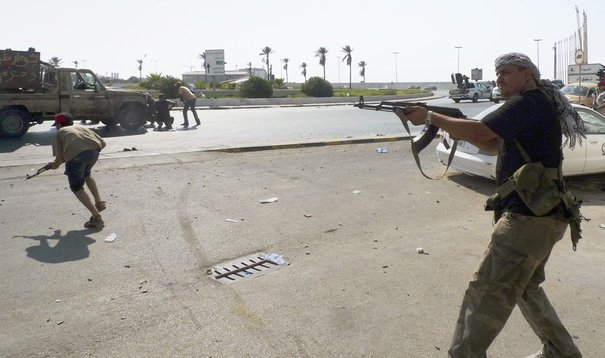 La révolte en libye - Page 4 761937_libyan-rebel-fighters-return-fire-during-an-attack-by-pro-gaddafi-forces-after-rebels-seized-a-gaddafi-army-women-s-officer-training-center-in-tripoli