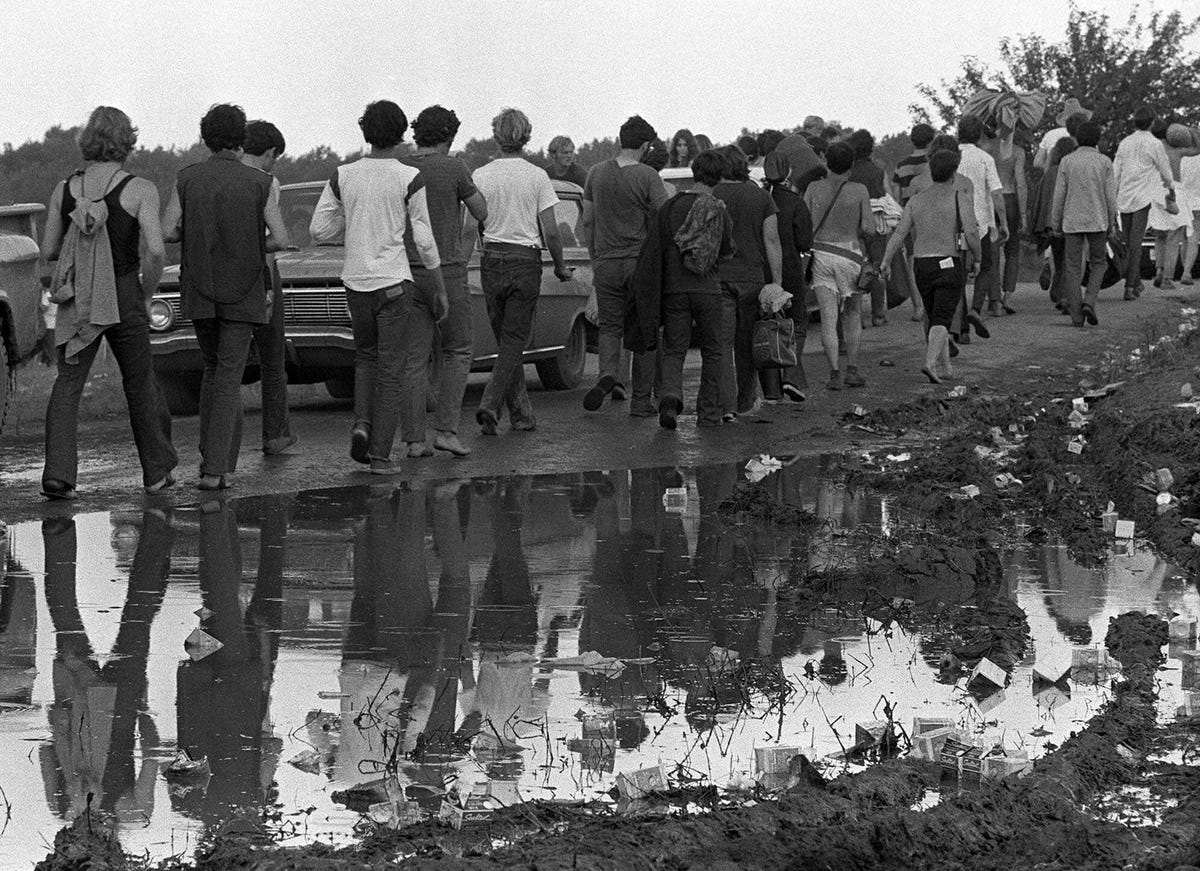 46 Years Ago Today, 500,000 People Descended On A Farm For The Greatest Music Festival Of All Time The-rain-created-massive-mud-puddles-and-many-festival-goers-found-themselves-caked-in-dirt