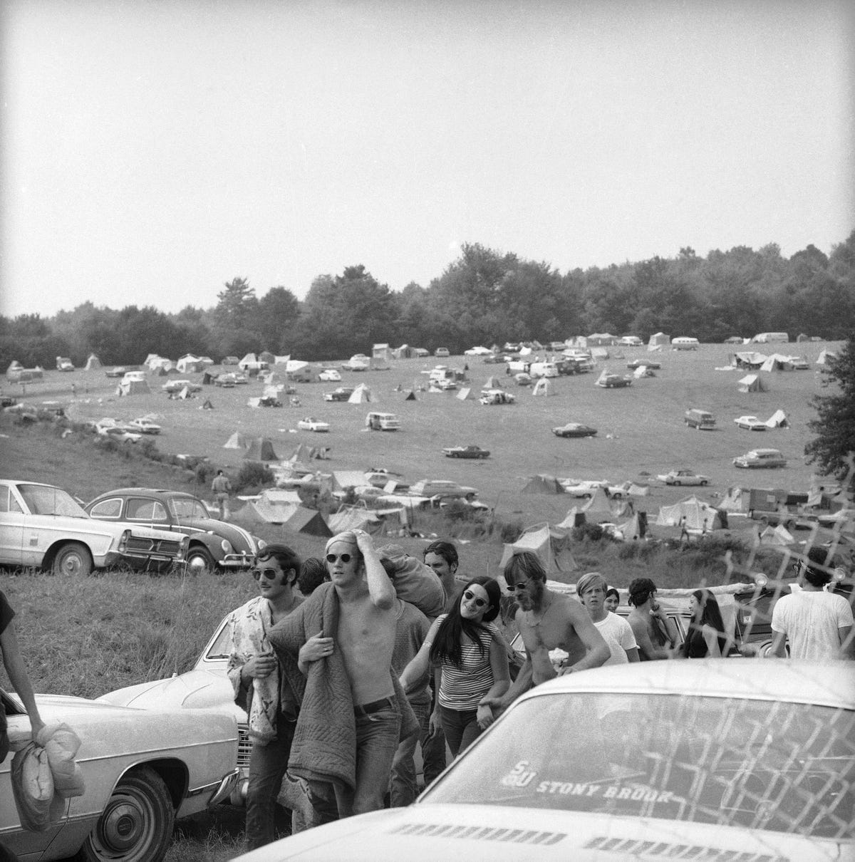 46 Years Ago Today, 500,000 People Descended On A Farm For The Greatest Music Festival Of All Time But-it-didnt-kill-the-vibes-here-attendees-leave-the-grounds-after-spending-a-rainy-night