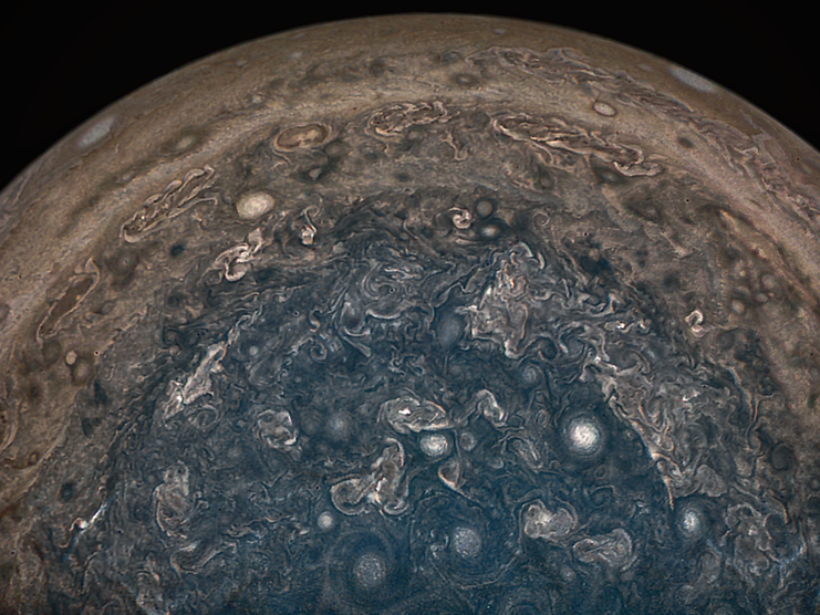 Jupiter's Swirling South Pole The-latest-nasa-images-of-jupiter-reveal-giant-white-storms-in-its-turbulent-south-pole