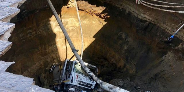 Giant sinkhole swallows garbage truck in Naples, Italy, prompting home evacuations Giant-sinkhole-swallows-garbage-truck-naples-italy