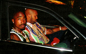 What's Pac holding in his hand? Tupac4