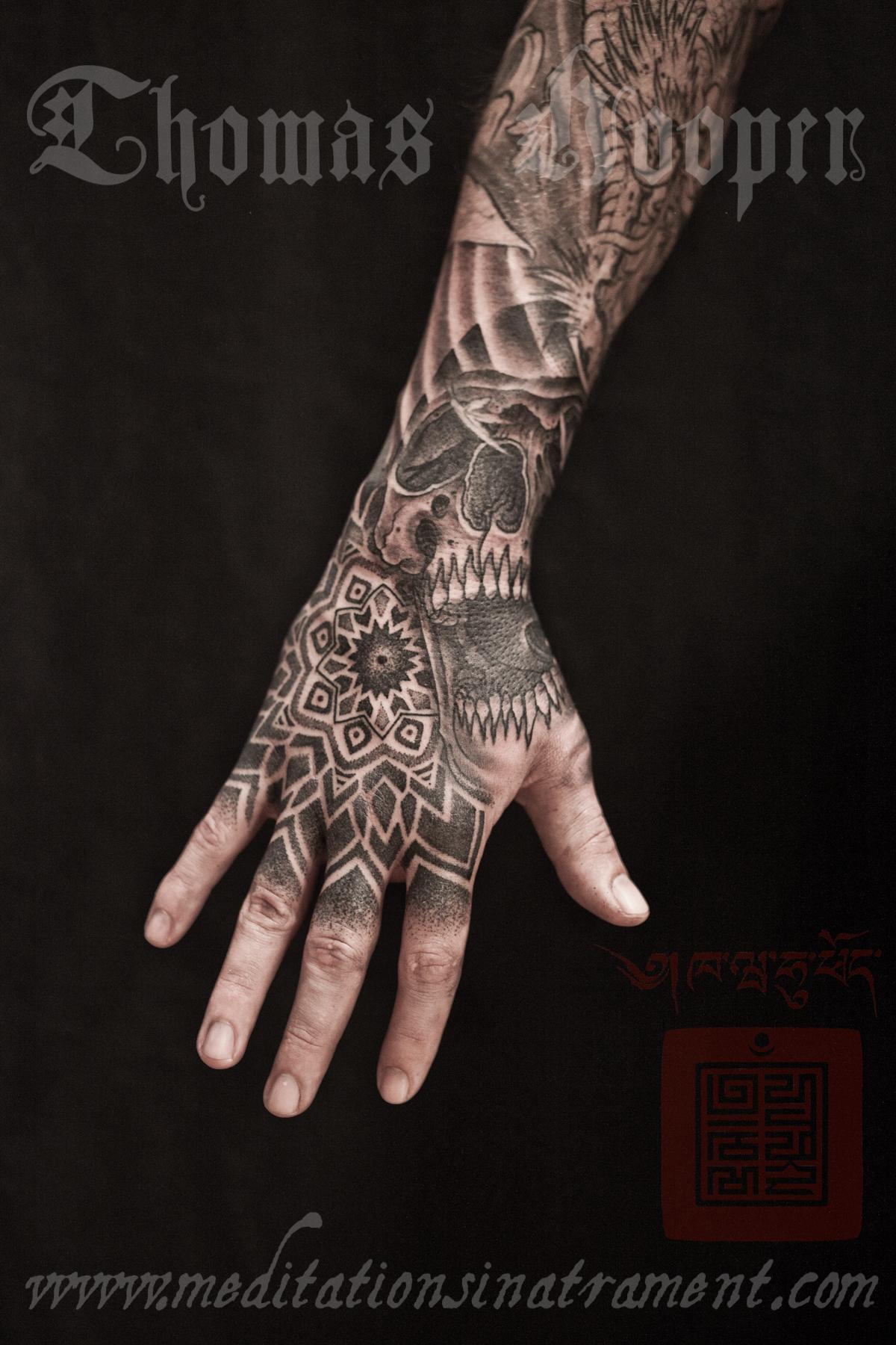 Freaky hand tattoo mandalas from New York City! Skull-hexahedron-and-mandala-hand-tattoo-thomas-hooper-008-august-02-2011