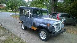 Some guys wives buy Coach Purses, Jewelry and Shoes....Mine buys an old postal jeep!  She's a keeper! A048f0324248861