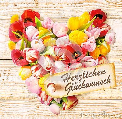 Натуся-Keeganing с Днем Рождения!!! German-birthday-wishes-colourful-floral-heart-formed-fresh-spring-tulips-vibrant-colours-arranged-rustic-wooden-37263592