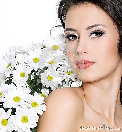 les éléments - Page 21 Verticale-de-femme-sexy-avec-les-fleurs-blanches-22244847