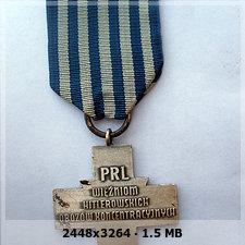 Auschwitz Cross medal 90b41749e2114269312ad0c81dc47802o