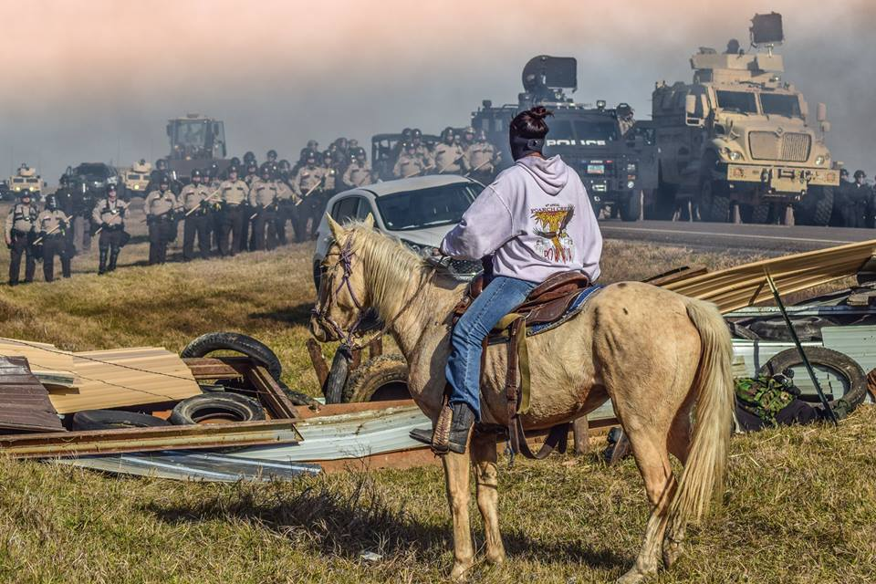 Water Protectors Call For Urgent Back-Up As Military Crosses Barricade Towards Protester Camps 14563370_1149903705075985_3700471635941934004_n