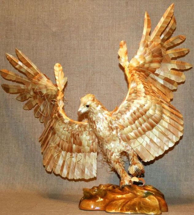 மரத்துகள்களில்+மரக்கட்டையில் அழகிய வேலைப்பாடு  Wood-chip-animal-sculptures-by-sergei-bobkov-1