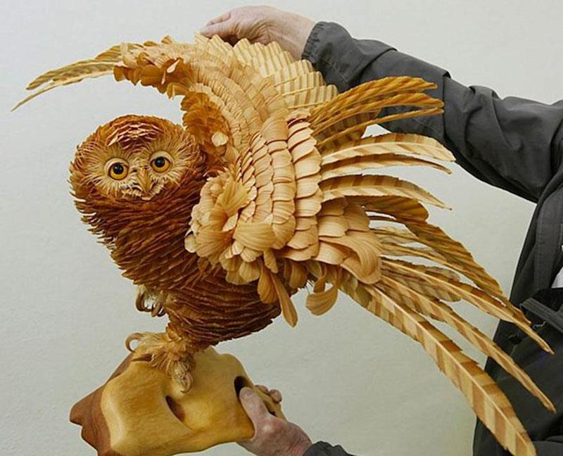 மரத்துகள்களில்+மரக்கட்டையில் அழகிய வேலைப்பாடு  Wood-chip-animal-sculptures-by-sergei-bobkov-3