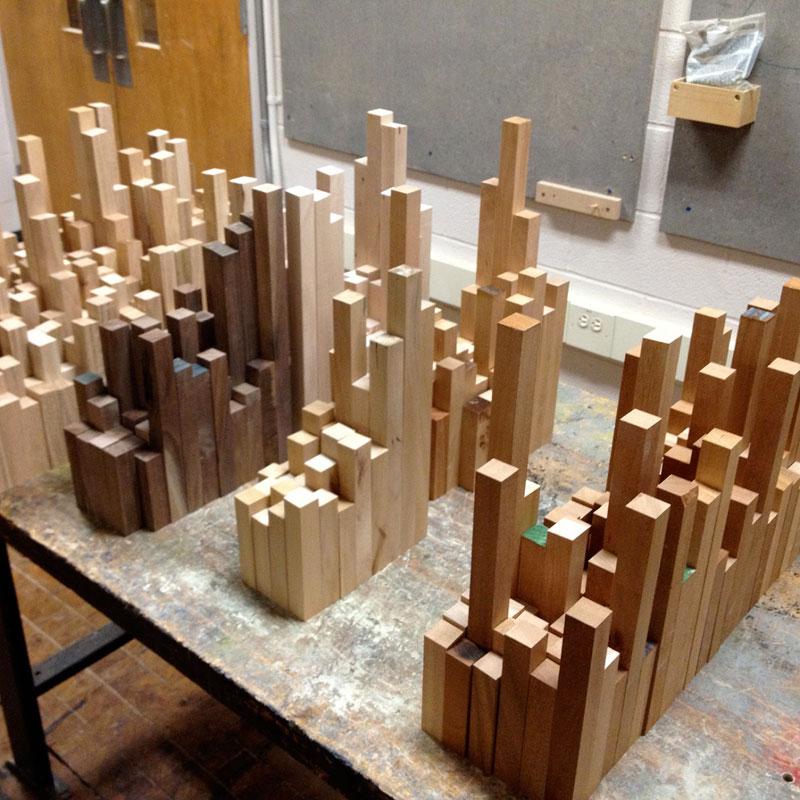 மரத்துகள்களில்+மரக்கட்டையில் அழகிய வேலைப்பாடு  Cityscape-sculpture-carved-from-wood-james-mcnabb-3