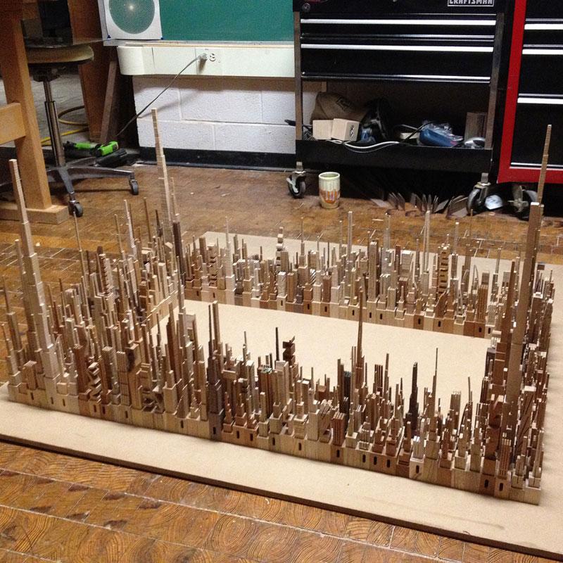 மரத்துகள்களில்+மரக்கட்டையில் அழகிய வேலைப்பாடு  Cityscape-sculpture-carved-from-wood-james-mcnabb-5