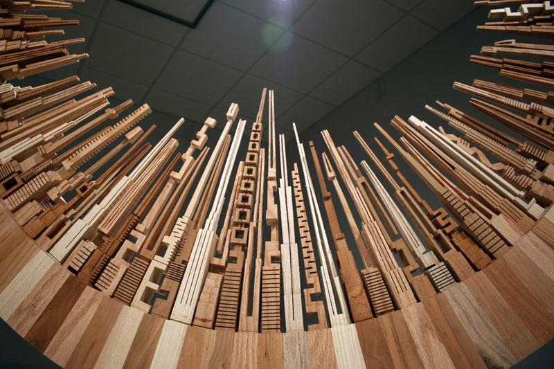 மரத்துகள்களில்+மரக்கட்டையில் அழகிய வேலைப்பாடு  Wooden-cityscape-wheel-carving-sculpture-james-mcnabb-1