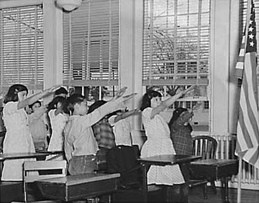 dinner at school. Students_pledging_allegiance_to_the_American_flag_with_the_Bellamy_salute