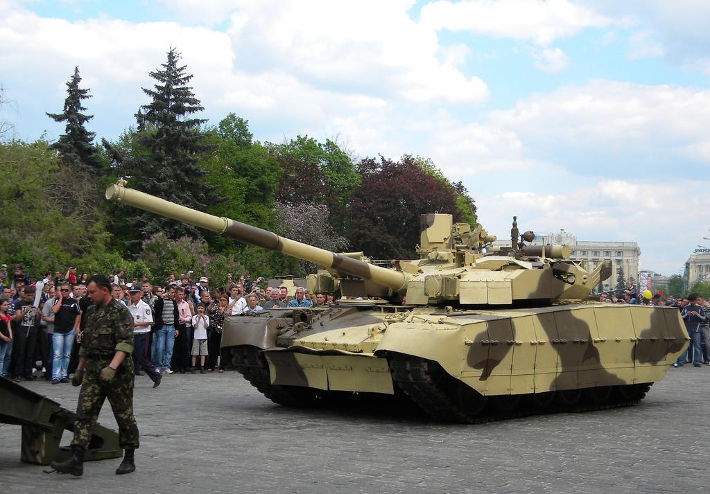 كون جيشك الخاص.... واربح 5 تقيمات  T-84_Oplat_guided_onto_a_tank_transporter