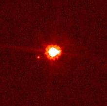Oq seria o Décimo planeta agora foi rebaixado para planetóide 220px-Eris_and_dysnomia2
