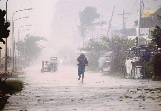 21 người đã thiệt mạng vì siêu bão Hagupit 1418031811_1
