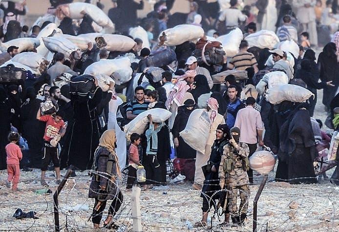 صور عن جحيم الفرار الجماعي من #تل_أبيض السورية 1e083ab9-c0bf-4be7-9f89-cbf7c578c9ab