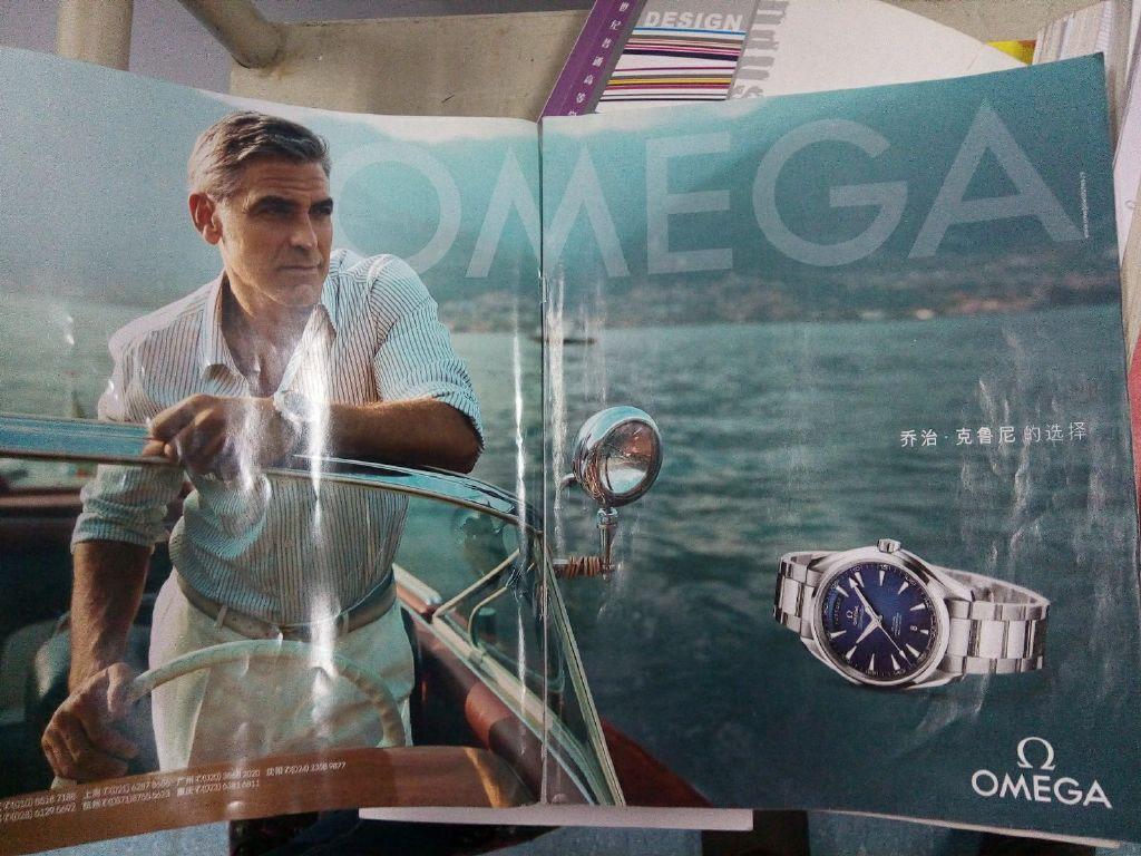 George Clooney and Einstein with Omega 693f7a02jw1eo14xlj76tj218g0xc48c
