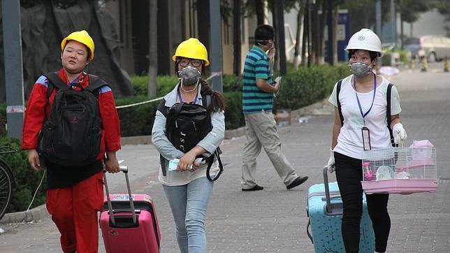 EXPLOSIÓN EN CHINA :  Ciudadanos de Tianjin se quejan de escozor en la piel tras primeras lluvias Tianjin%207--644x362