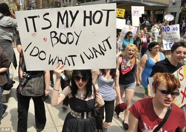 Anger: A scene from last weekend's Boston SlutWalk, held in response to the Canadian police officer's comments that women should 'avoid dressing like sluts in order not to be victimised'