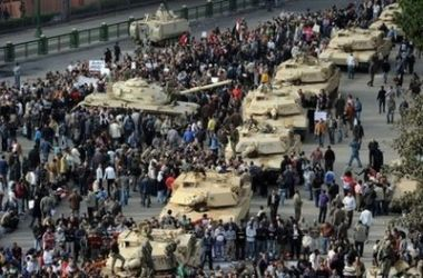 Egyptian Armed Forces Photos and Videos A_column_of_abrams_tanks_line_the_street_as_egyptian_protesters_gather_in_tahrir_square_in_cairo_01022011