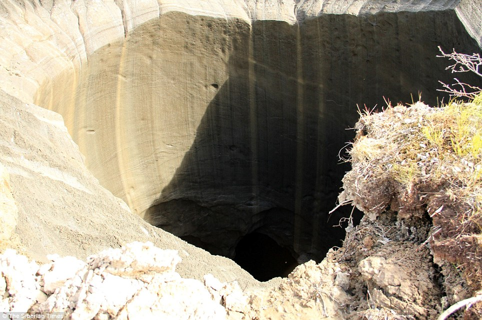 A new crater has been found in Russia after a mass UFO sighting Article-2696953-1FBF277A00000578-973_964x641