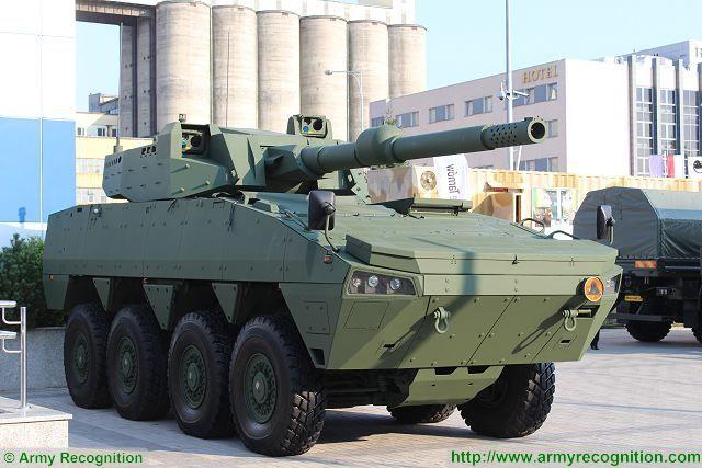 اهم مشاهد معرض MSPO 2015 Cockerill_XC-8_120mm_turret_CMI_Defence_Rosomak_8x8_armoured_MSPO_defense_exhibition_Kielce_Poland_640_001