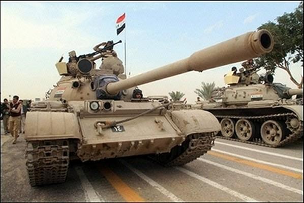 الموسوعة الأكبر لصور و فيديوهات الجيش العراقي 2 - صفحة 2 Iraqi_T-55_main_battle_tank_17122007_news_001