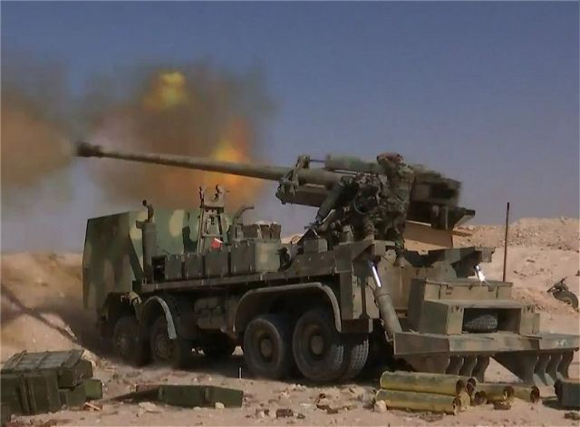 مدفع M-46 عيار 130 ملم الذاتي الحركه المدولب المطور من قبل الجيش السوري  Syrian_military_forces_produced_locally_130mm_M-46_8x8_self-propelled_howitzer_640_003