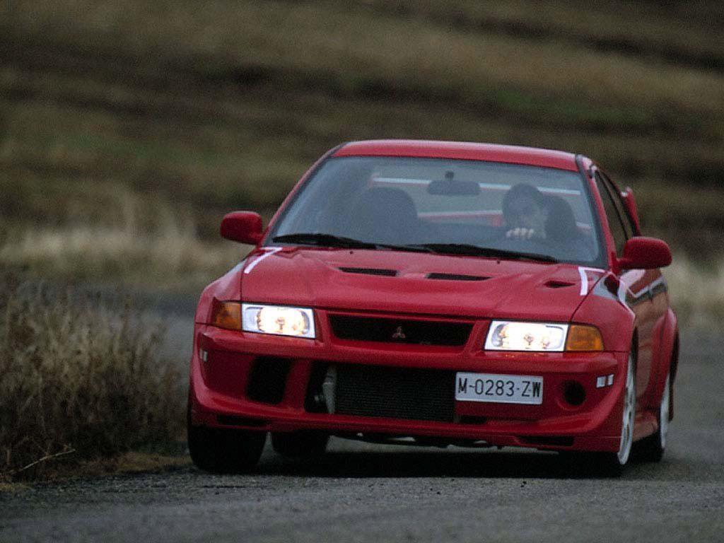 Tu garaje de 5 coches... un debate abierto en mil sitios. Mitsubishi_lancer-evolution-vi-tommi-makinen-edition-1999_r5