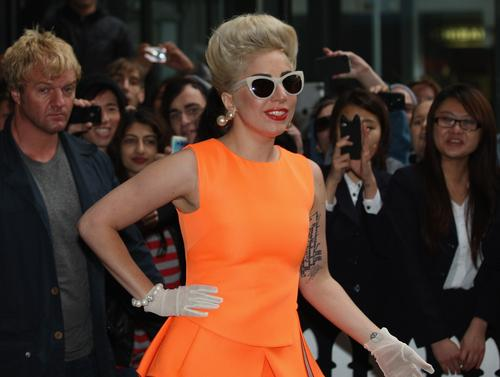 ~News Lady-GaGa-orange-dress-arriving-in-Auckland-JUNE-5-2012_07