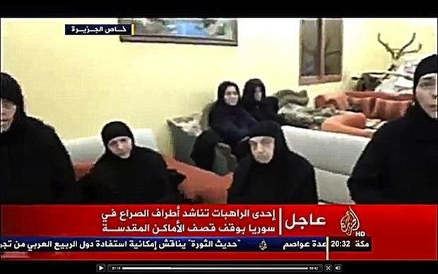 Religieuses enlevés par les islamistes - Page 2 SYRIA-_Maaloula_nuns_in_video