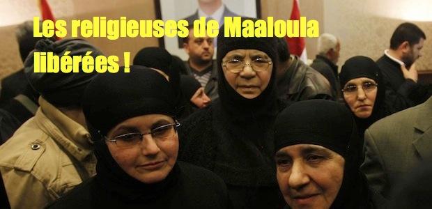 Religieuses enlevés par les islamistes - Page 2 2014-03-10T053637Z_828758342_GM1EA3A0RM201_RTRMADP_3_SYRIA-CRISIS-NUNS_0