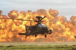 طائرات الاباتشى تدك 4 عربيات تحاول اختراق حدودنا الغربية لليبيا Coptstoday-1423502689