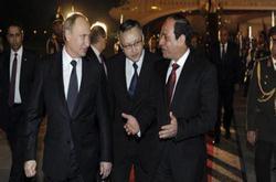 بالفديو لحظة وصول الزعيم الروسى بوتين لارض الكنانة  Coptstoday-1423505585