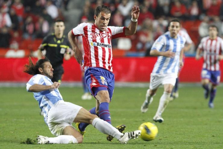 Real Madrid-MÁLAGA (Domingo 18 de marzo, 21:30 horas)  - Página 5 Demichelis_gijon