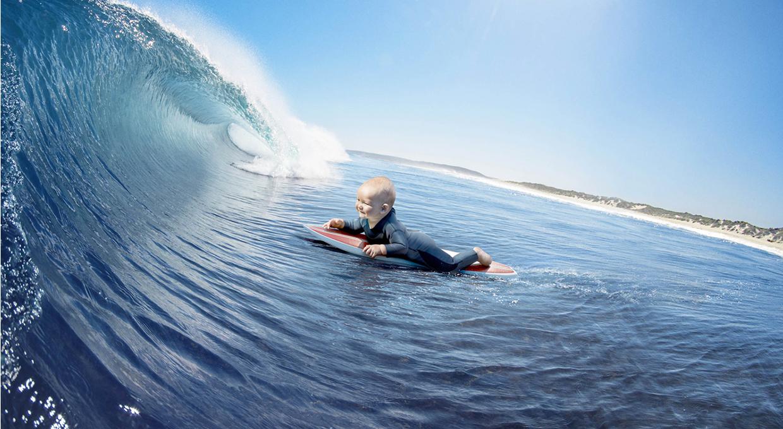 [Jeu] Association d'images - Page 20 Evian-live-young-publicite-bebe-surf