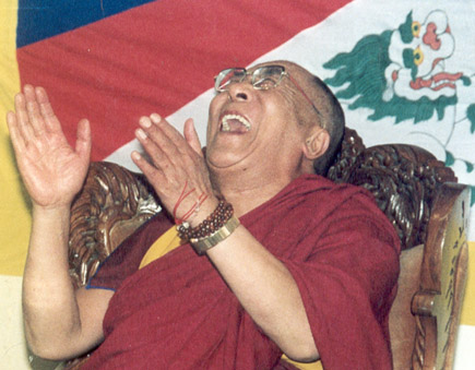 Tenzin Gyatso, a.k.a. the 14th Dalai Lama - spiritual leader of Tibet Dalai-lama-laughing-hands