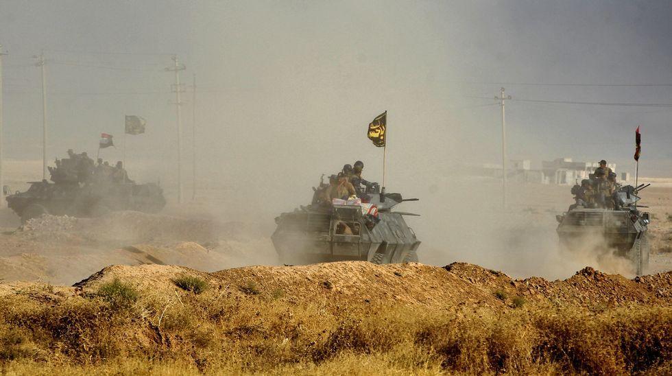 Irak: Crisis políticas, tensiones  sociales  y luchas militares interburguesas. - Página 13 Afp_20161017_072307476