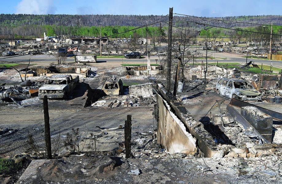 L'actualité vue par TSGE et ... Goolge Earth !  :) - Page 20 Des-quartiers-entiers-de-fort-mcmurray-ont-ete-reduits-en_2922649