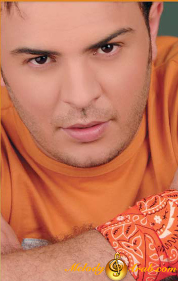 اطلب صوره لفنان والي بعدك يجيبهاا - صفحة 8 Melody4ara.com_Ahmed_El_Sherif_559