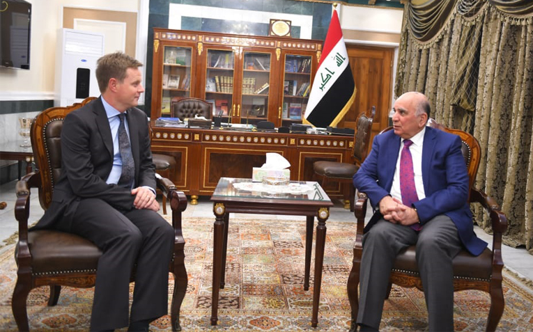 The Deputy Prime Minister and Minister of Finance receives the UK ambassador to Iraq Mof5456