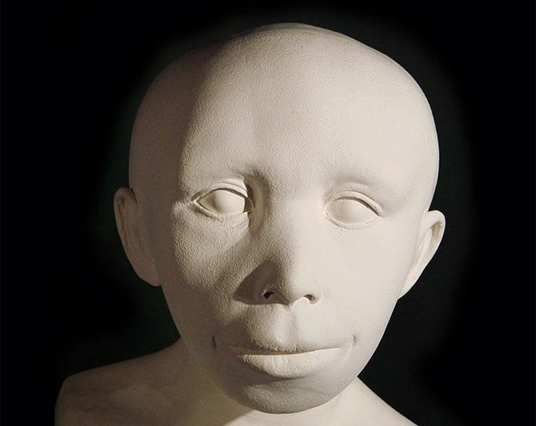 Explication de la forme particulière du visage de Néandertal Neanderthal-child-face-reconstruction