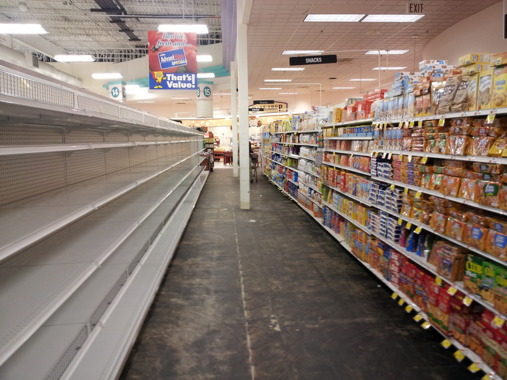 The First 10 Foods That Disappear From Store Shelves During Disasters Grocery-shelves-flickr-creative-commons