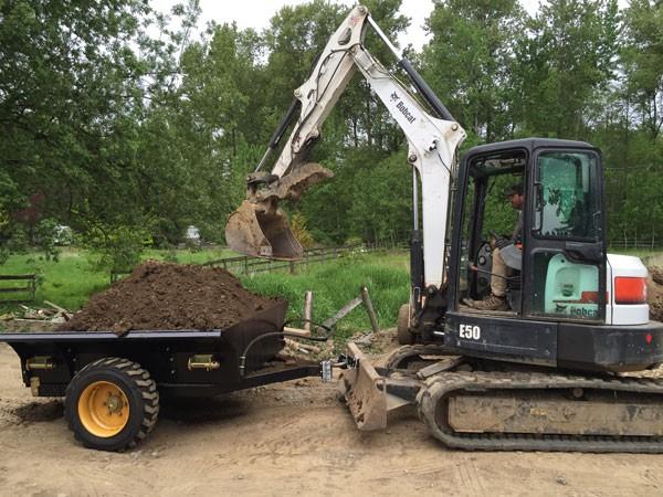 escavatore gommato Dump-trailer-for-excavator-600-0039-75a80e889e