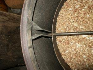 [Energie] Se chauffer au bois Passerelleco.info_poele_a_sciure_vue_de_dessus