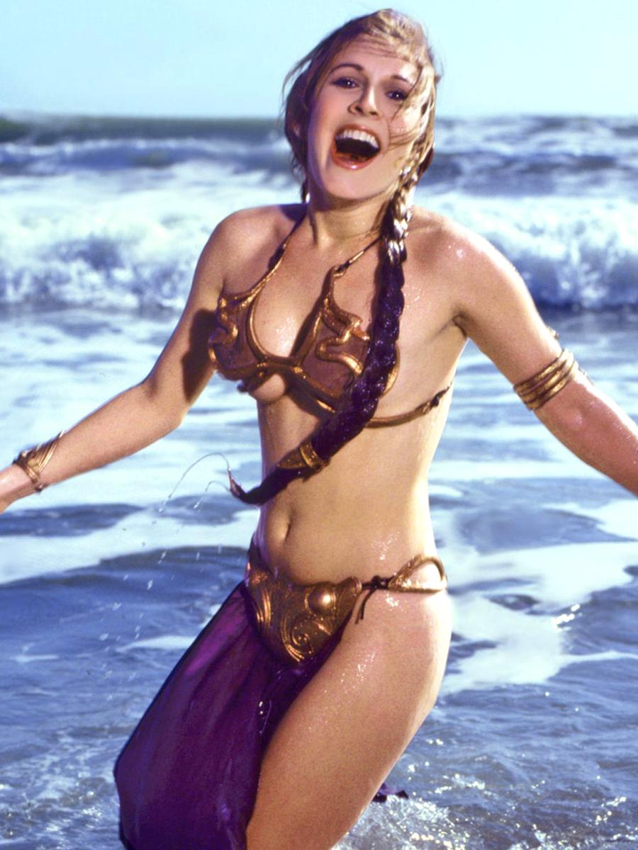 Imagenes cinéfilas - Página 6 Carrie-Fisher-Golden-Bikini-in-Rolling-Stone-Magazine-1983-03